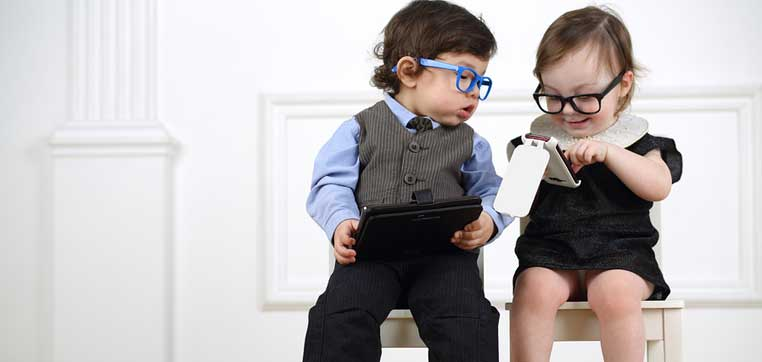 2 little kids reading about preferential financial aid