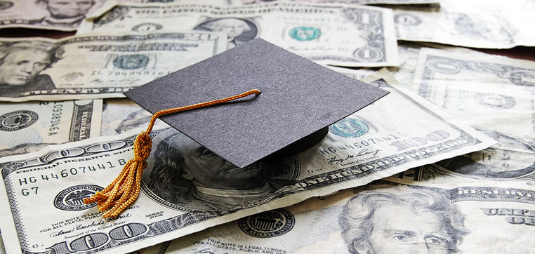 Graduation had on money representing college costs