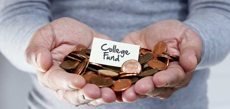 hands holding money representing most expensive college for low income students